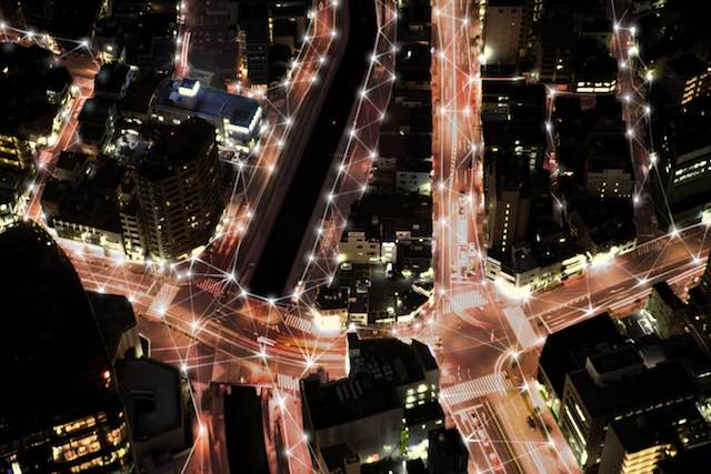 Aerial View Of Illuminated City Street At Night